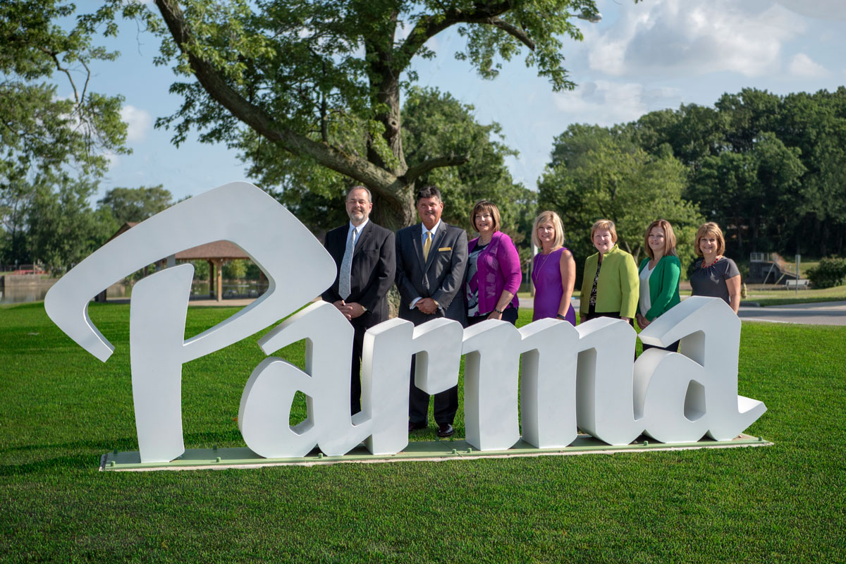 PSE team standing next to the Parma sign